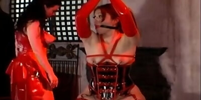 red latex mistress plays with girl